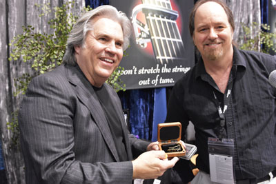 Doyle Dykes shows off his new engraved capo.
