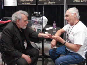 Discussing the specs of the banjo capo with Eddie at the Summer NAMM show in Nashville.